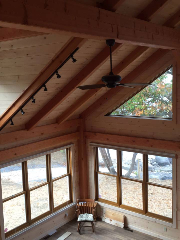 timber frame ceiling with a pickling board finish and a ceiling fan