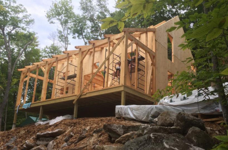 Exterior of a timber frame camp in progress