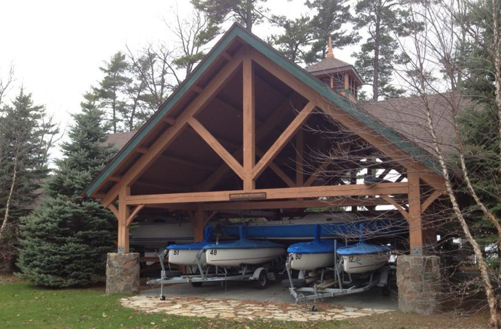 Finished exterior of a pavilion with boat storage