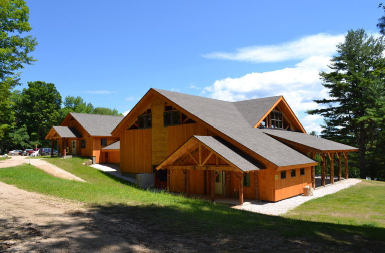 Finished exterior of a timber frame summer camp pavilion