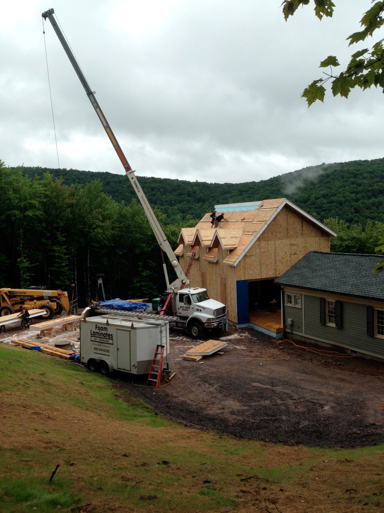 SIPS being installed with a crane on a timber frame