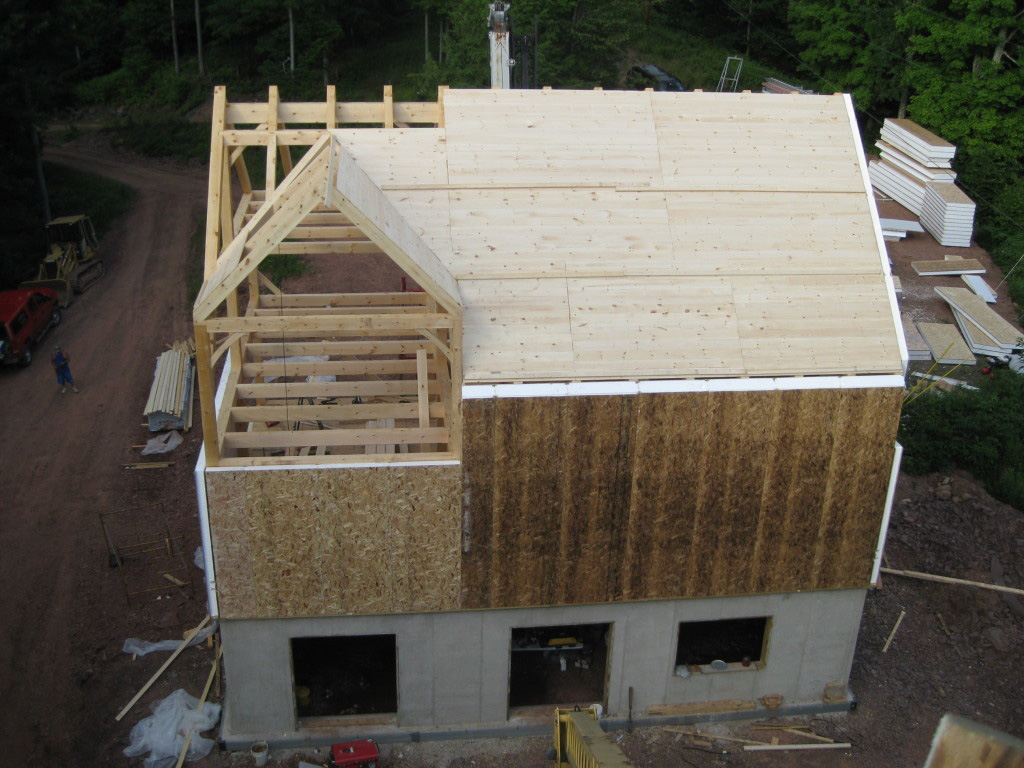 drone shot of SIPs being installed on a timber frame exterior