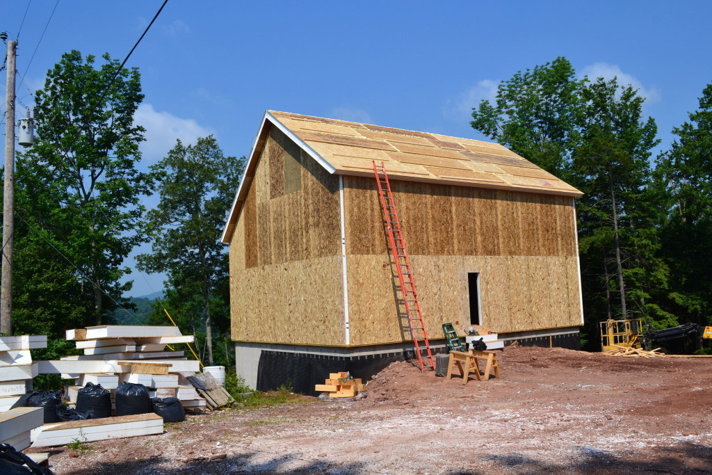 SIPs installation on a timber frame exterior