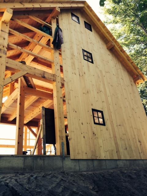 Half finished side of a timber frame barn