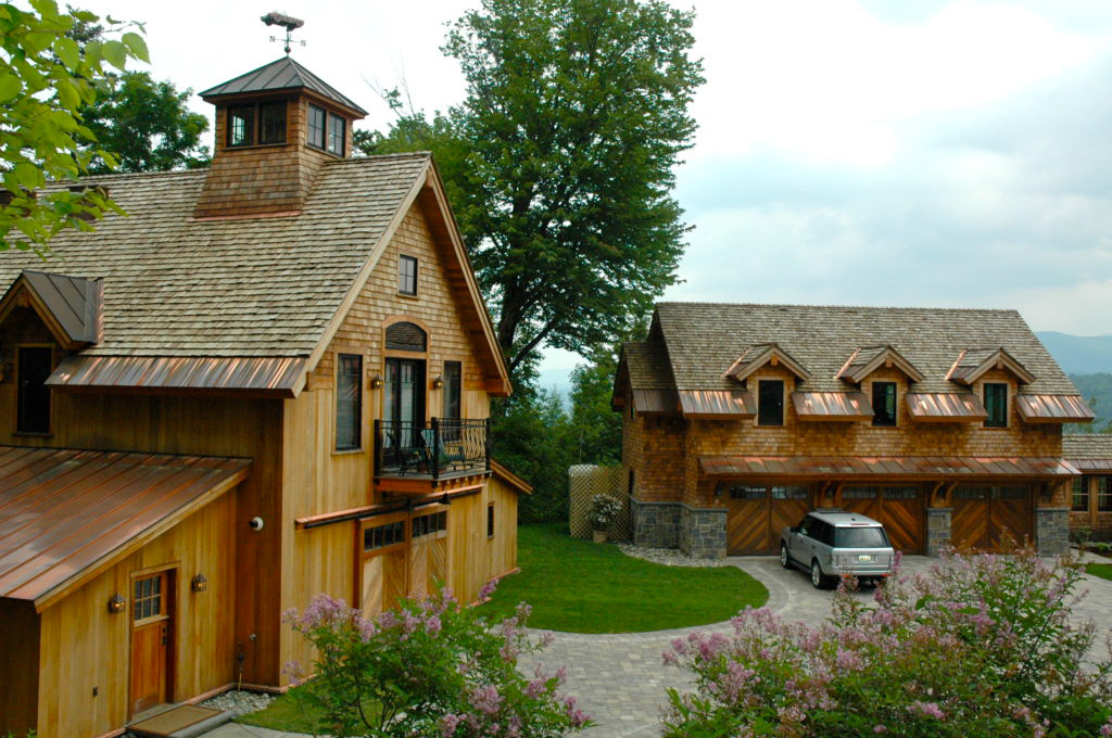 Finished timber frame barn next to a timber frame garage