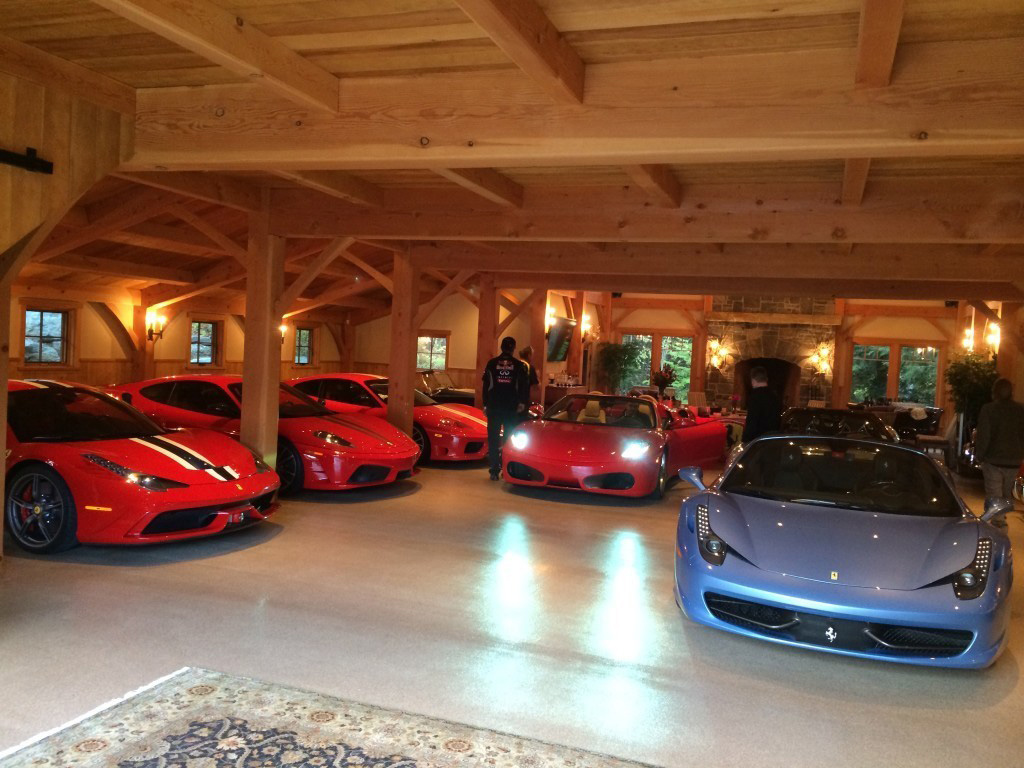 Interior of a timber frame barn with a lot of car storage