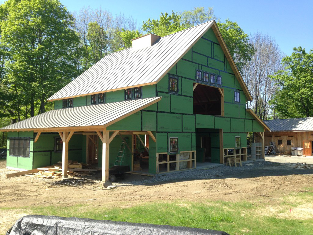 Timber frame barn with a finished roof, no siding