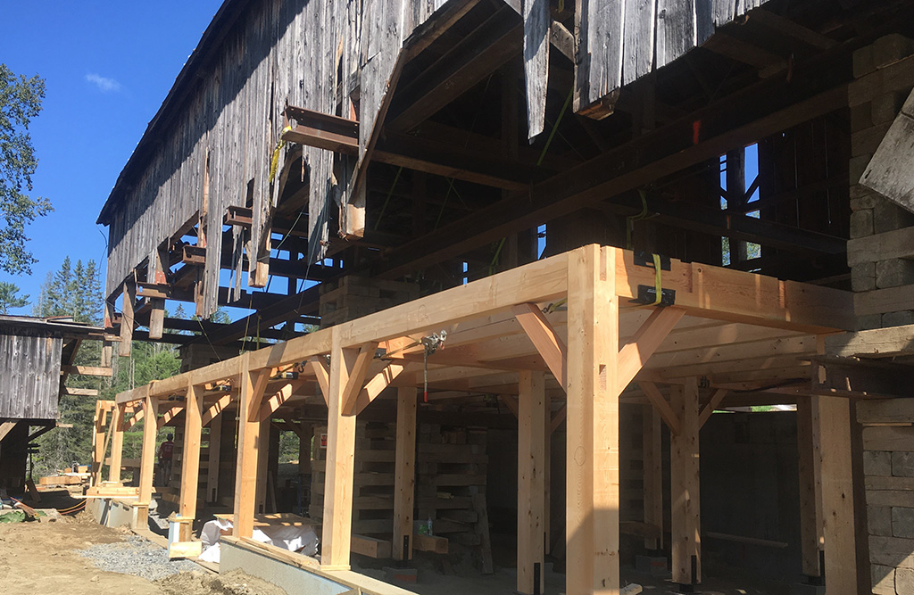 Timber frame installed to support the bottom an old Vermont barn