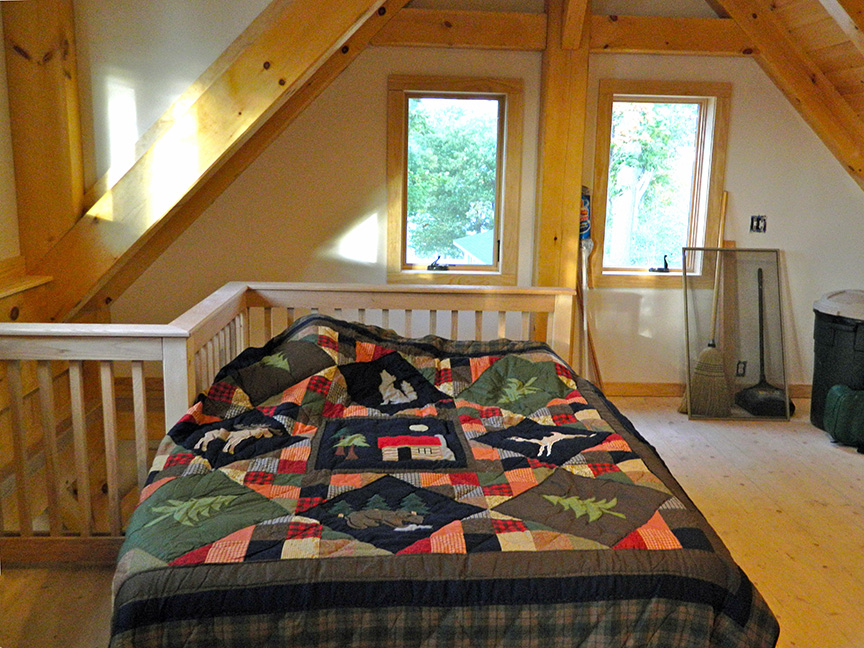 Bedroom in a timber frame camp