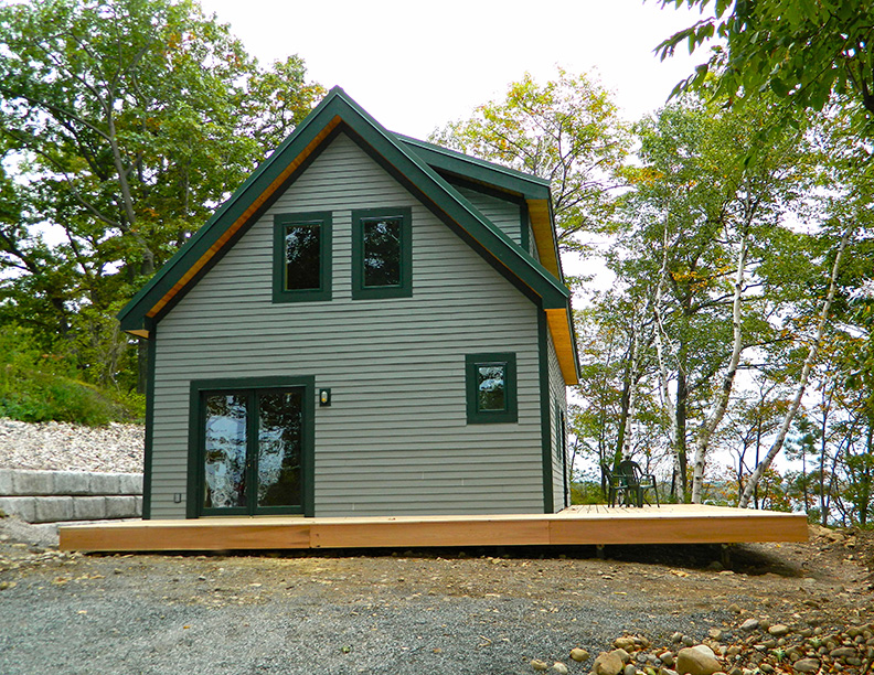 Finished exterior and porch of a timber frame camp