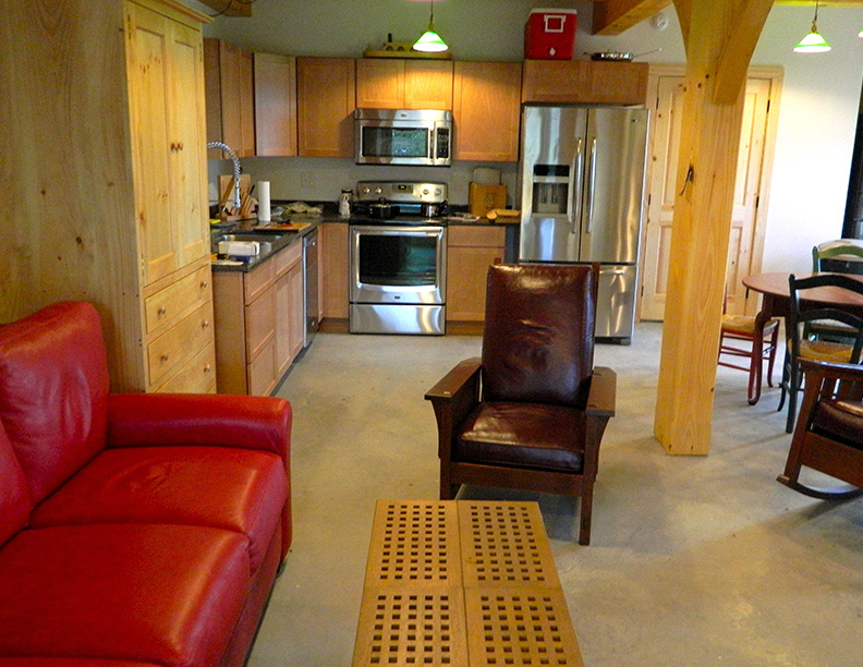 Kitchen and living room in a timber frame camp
