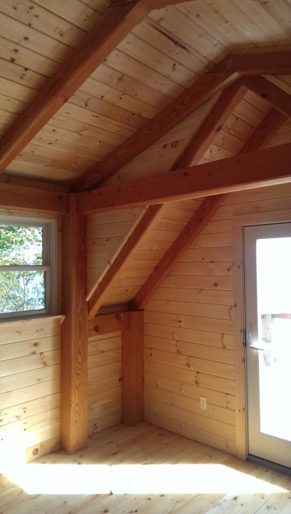 Ceiling beams in a timber frame camp