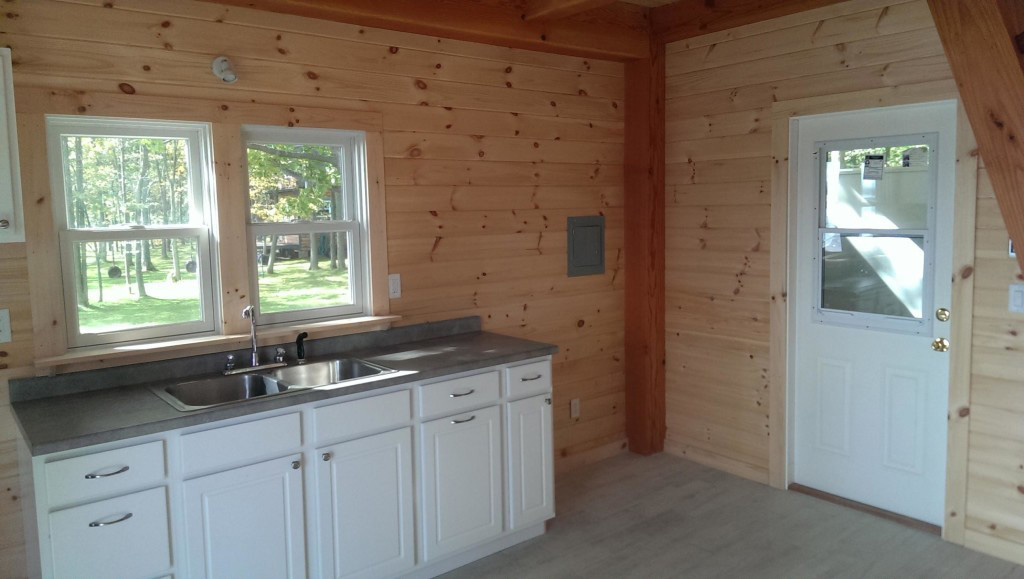 Kitchen area in a timber frame camp
