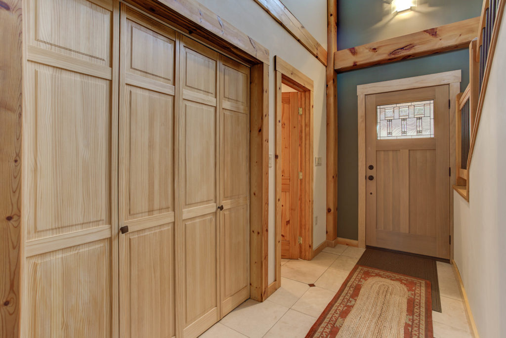 Entryway and closet in a timber frame cape