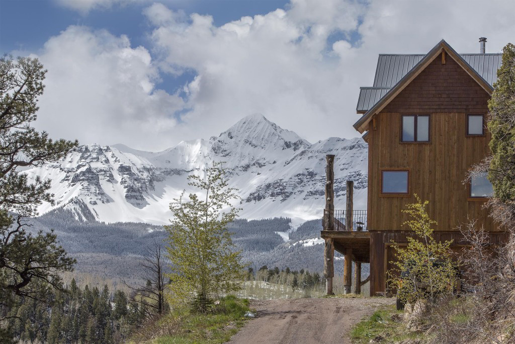 Mountains and an exterior of a timber frame cape