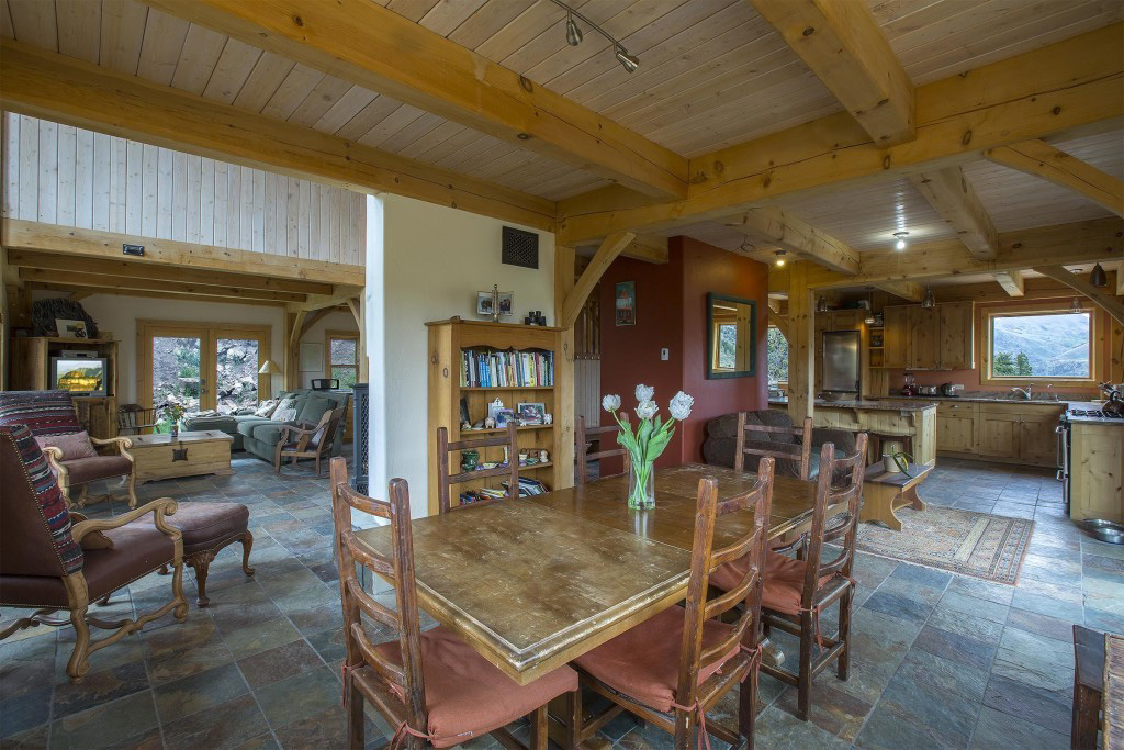 Kitchen, living room, and dining room in a timber frame cape