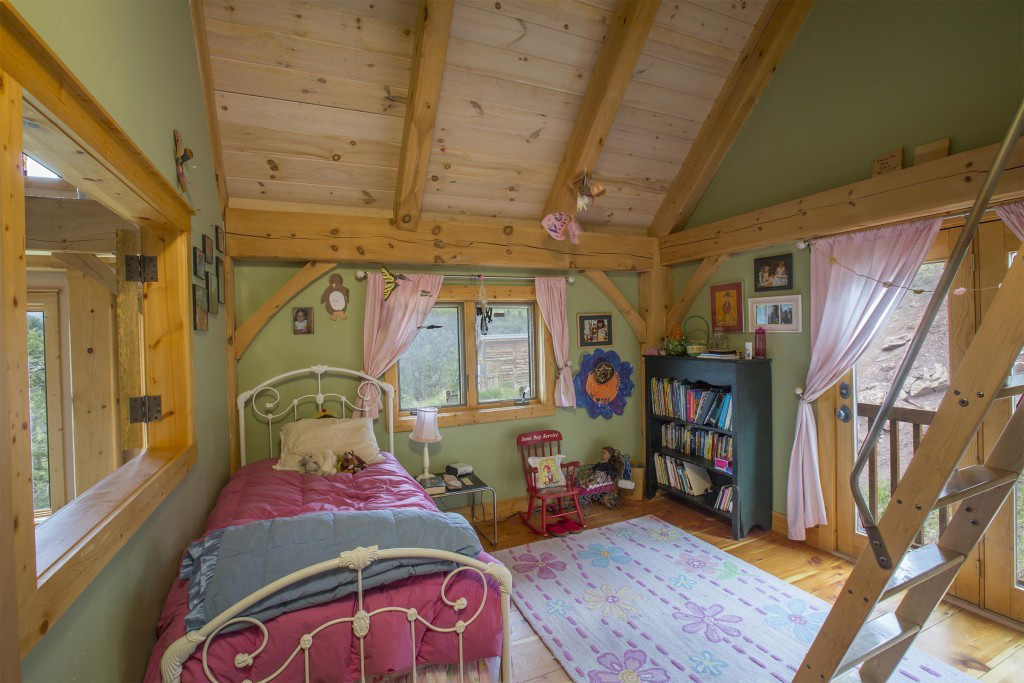 Bedroom in a timber frame cape
