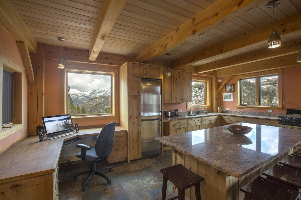 Kitchen and desk in a timber frame cape