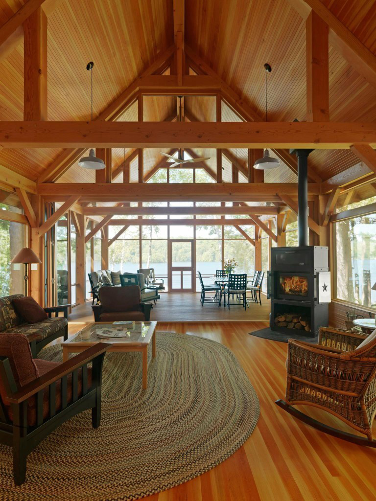 Kitchen and living room in a timber frame cape
