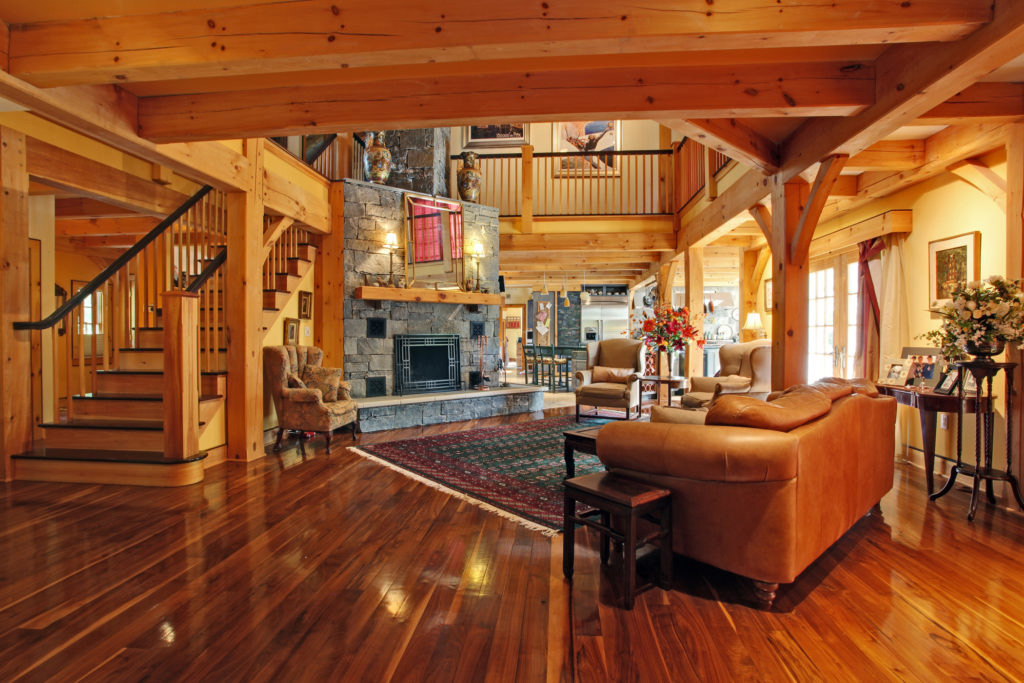 Living room and staircase to the second floor in a timber frame colonial