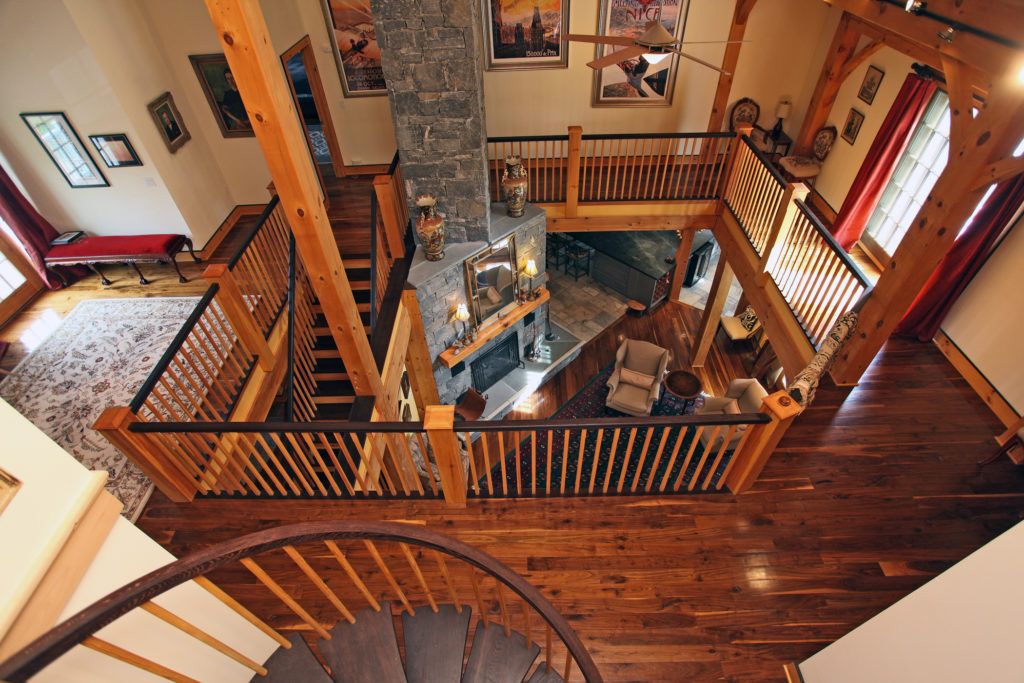 Looking down on the second and first floor in a timber frame colonial