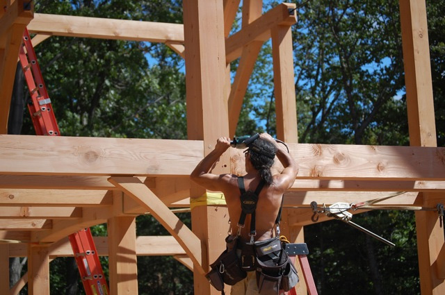 Employee working on a timber frame colonial