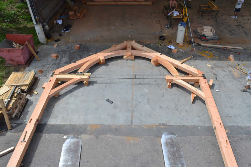An arch of a timber frame colonial about to be raised to the structure