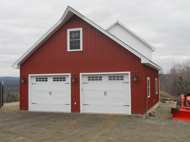 Garage attached to a timber frame colonial