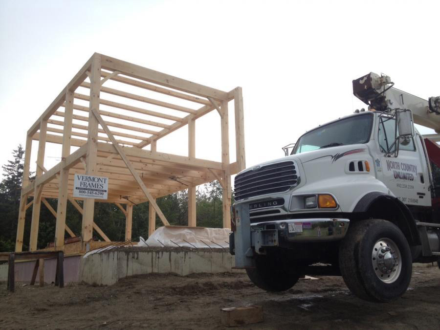 Vermont Frames timber frame structure and a truck