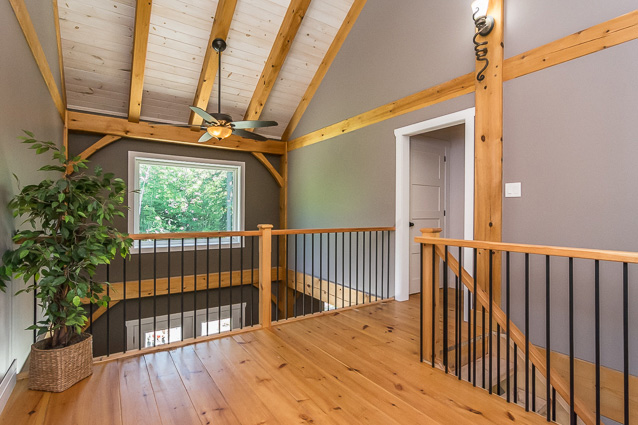 Second floor hallway in a timber frame dutch saltbox