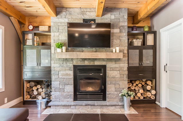 Stone fireplace in a timber frame dutch saltbox