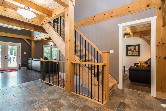 Exposed stairwell in a timber frame dutch saltbox