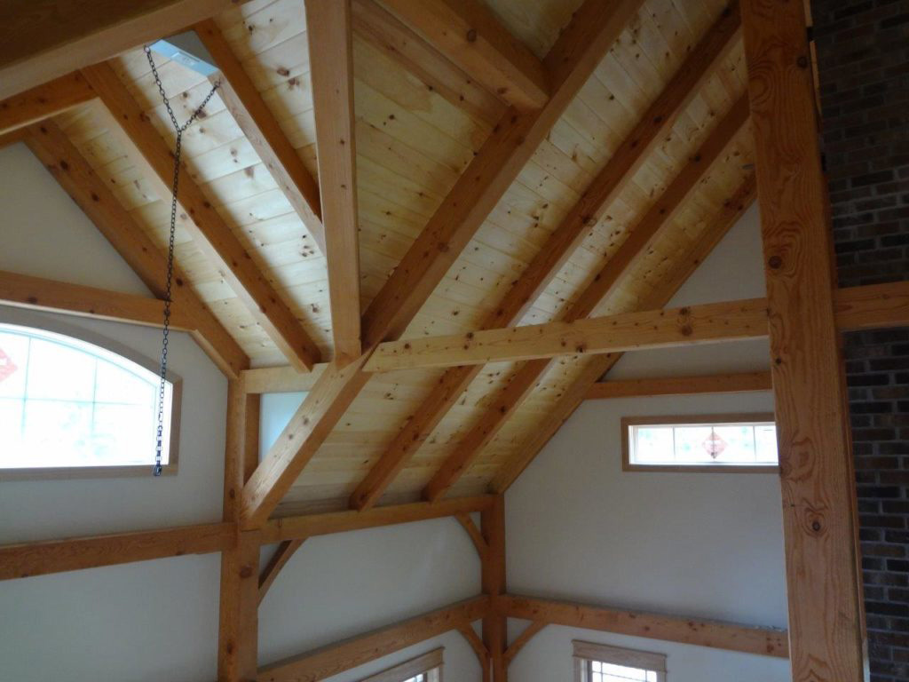 Interior ceiling beams in a timber frame dutch saltbox