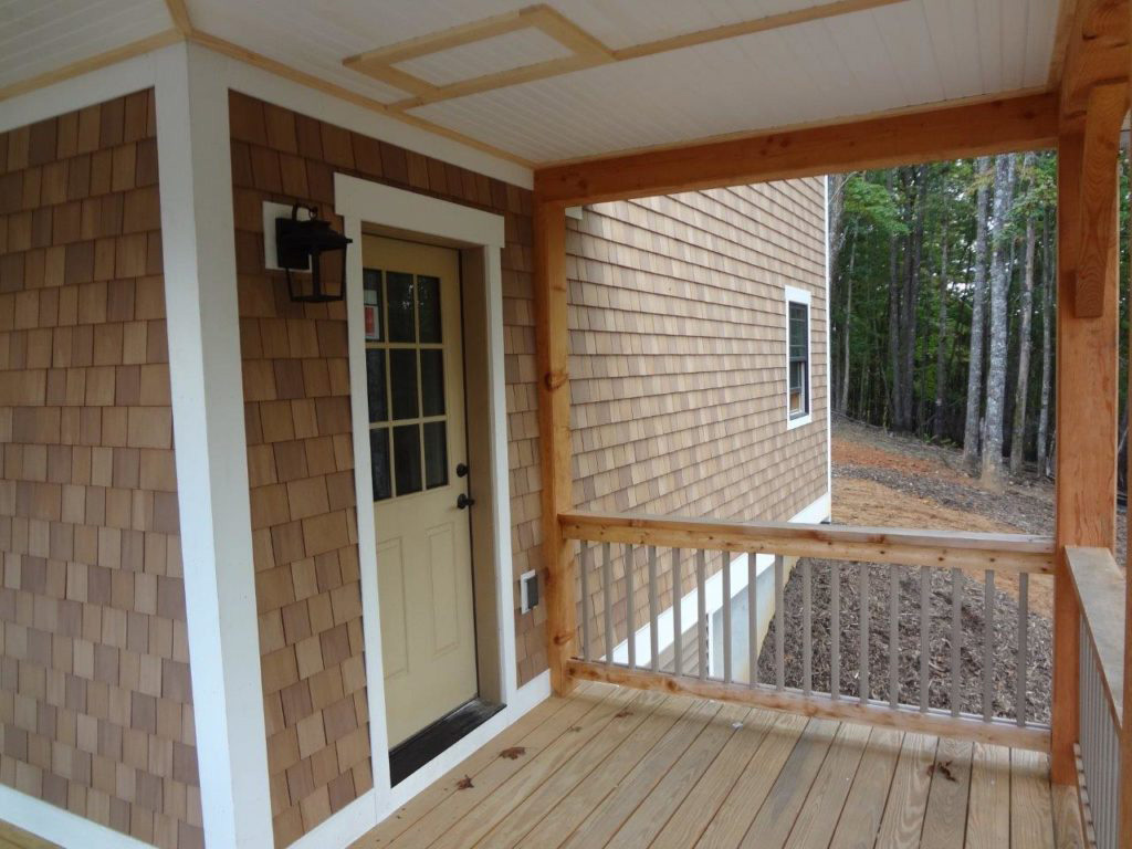 Outdoor porch on a timber frame dutch saltbox