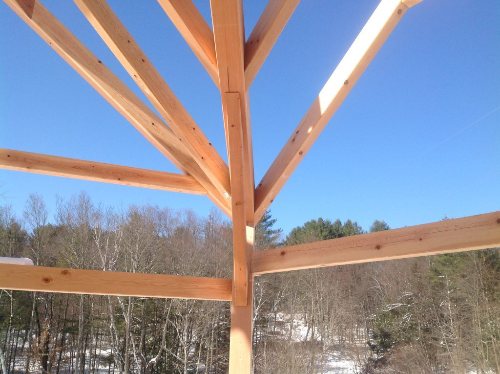 Close of of the beams in a timber frame dutch saltbox structure