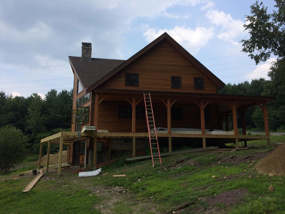 Finished exterior of a timber frame dutch saltbox