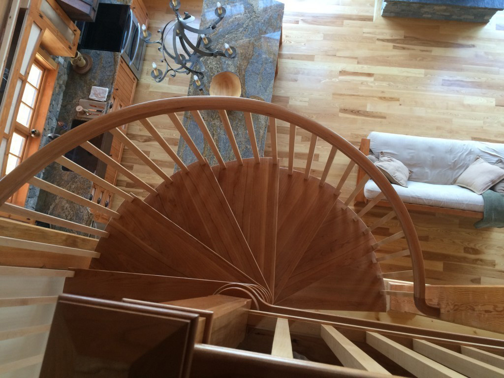 Spiral staircase in a timber frame dutch saltbox