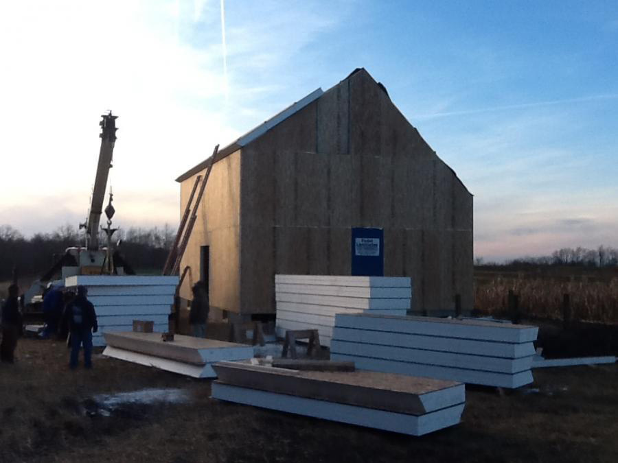 Timber frame dutch saltbox structure with SIPs and a crane