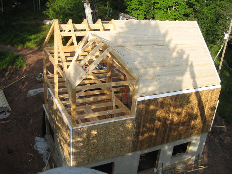 Overhead shot of a timber frame dutch saltbox structure with sides