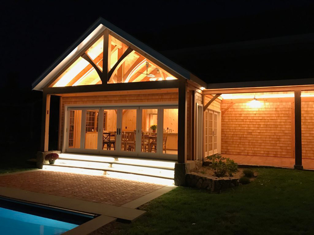 Finished exterior of a timber frame pavilion at night