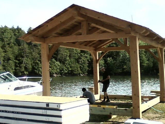 Timber frame structure of a pavilion and a stack of SIPs