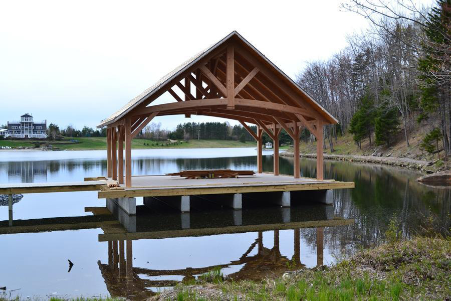 Finished timber frame pavilion on a lake
