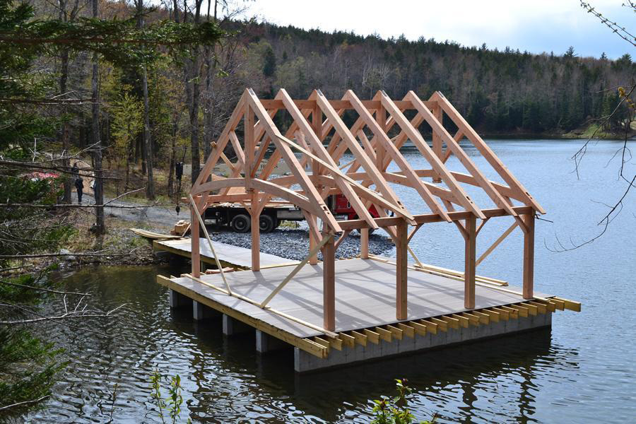 Timber frame pavilion structure on a lake