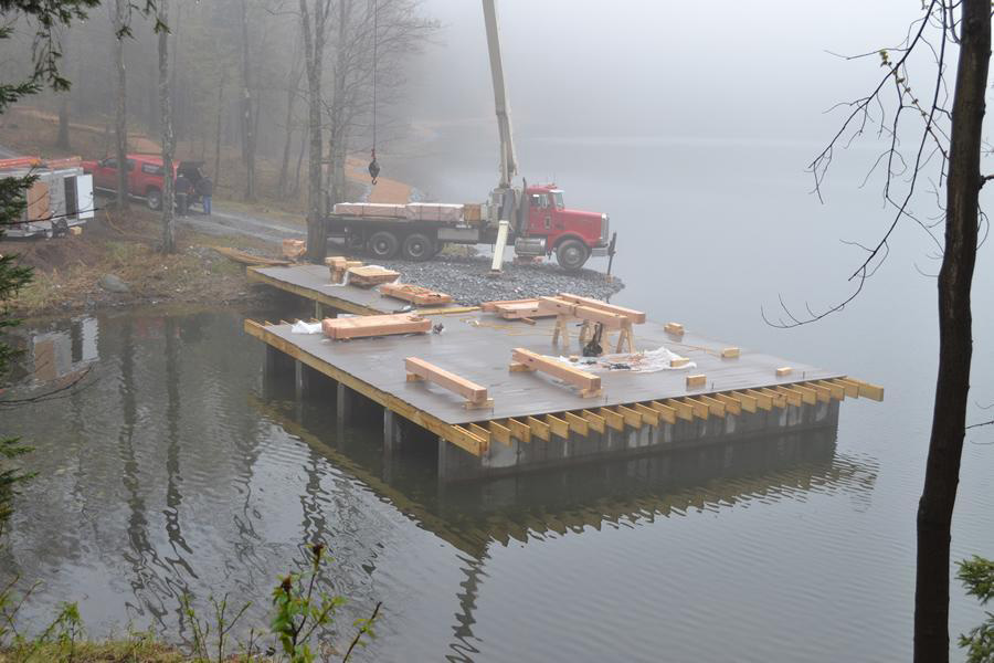 Platform on the lake for the timber frame pavilion structure