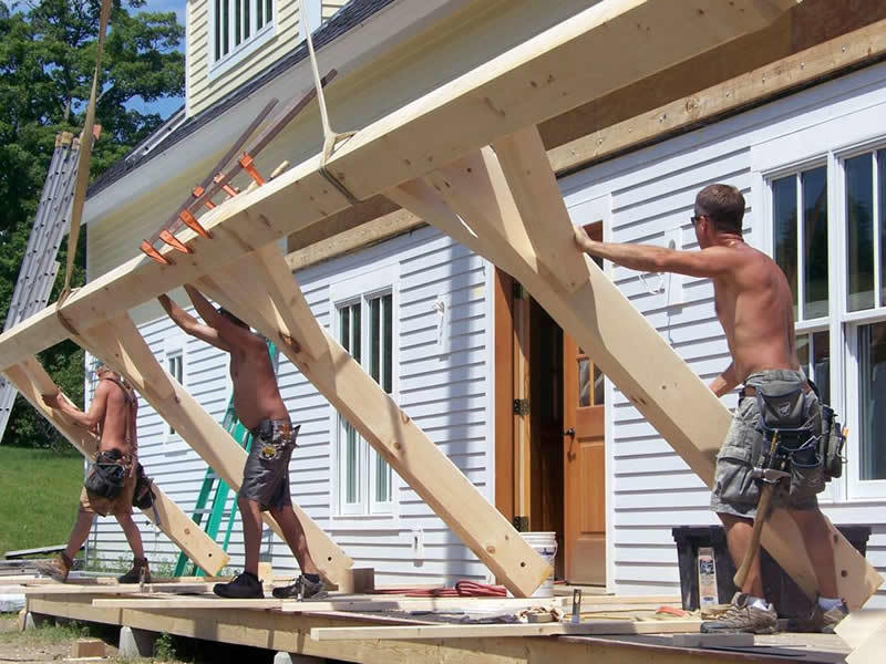 Assembling the porch of a timber frame restaurant