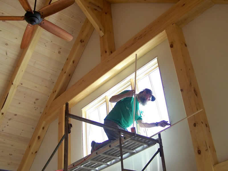 Working on the windows of a timber frame restaurant