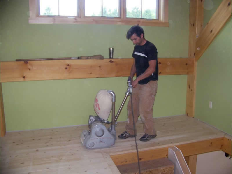 Sanding the floor of a timber frame restaurant