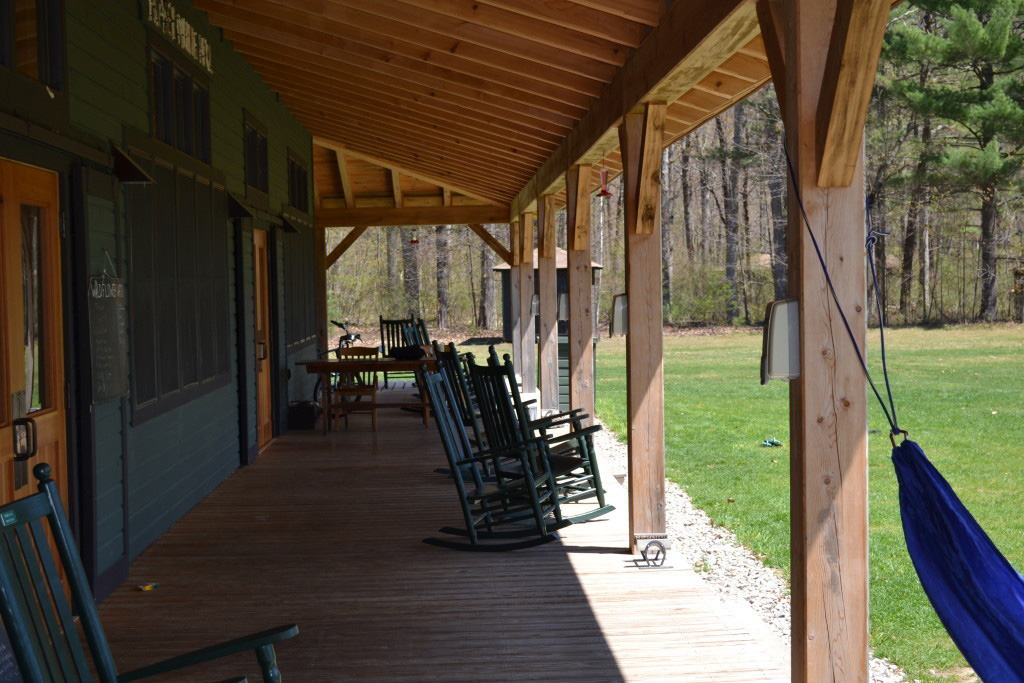 Porch and rocking chairs at a timber frame summer camp mess hall