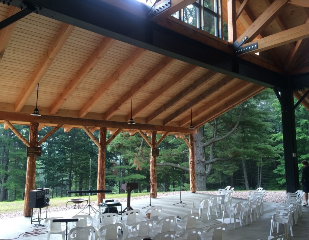 Finished interior of a timber frame summer camp pavilion
