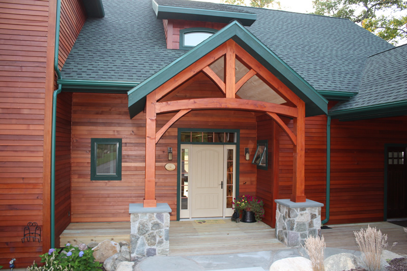 Timber Frame entryway on a wood-sided house
